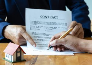 Signing a home purchase contract.