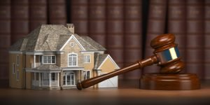 House with gavel and law books. Real estate law and house aucti